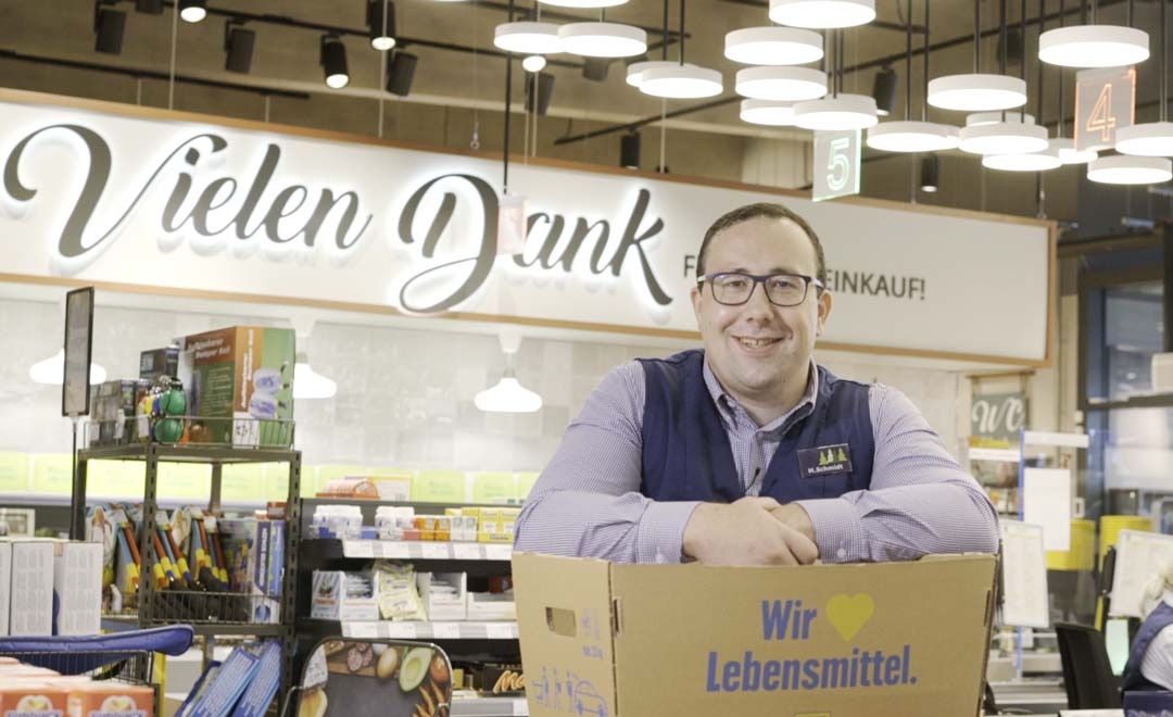 Managing Director Martin Schmidt in the check-out area of the Edeka supermarket.
